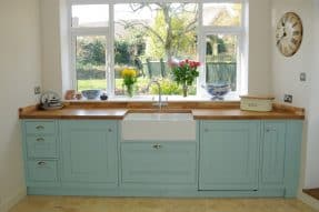 Haydown bespoke kitchen with oak worktops.